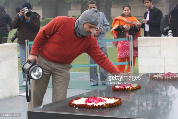 A security man checking the flowers before the arrival of Delhi Chief Minister Shiela Dikshit paying who came to pay tribute to those who died in...