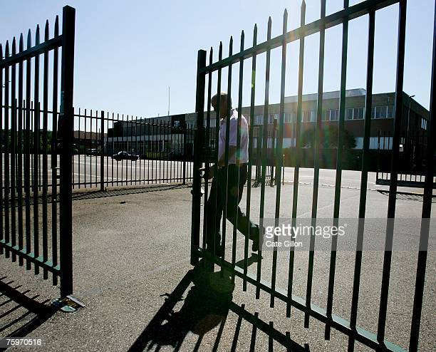 A security man closes the gate outside Merial the company that produces the foot and mouth vaccine situated by the Institute for Animal Health...