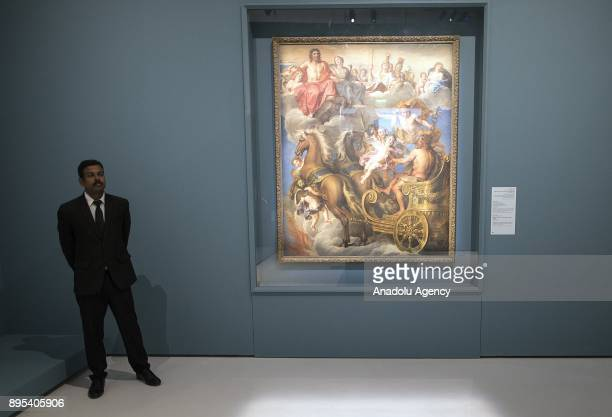 A security man is seen during the press preview of the 'From One Louvre to Another' exhibition at the Louvre Abu Dhabi in Abu Dhabi United Arab...