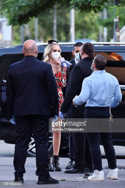 Security man measures the temperature to Chiara Ferragni before the Aniye By fashion show at Magazzini Generali on June 22, 2020 in Milan, Italy.