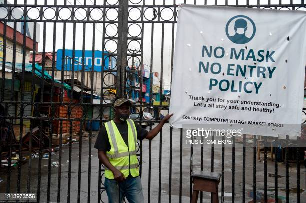 Security man stands at the main gate of Computer Village, the largest Information and Communications Technology accessories market in African...