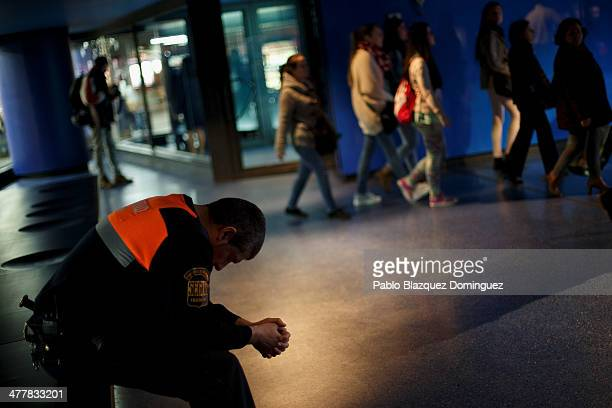 A security man visits the memorial monument for the victims of Madrid train bombings at Atocha railway station during the 10th anniversary on March...