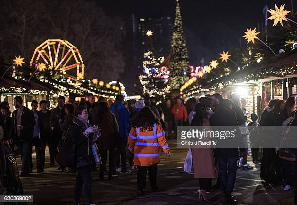 A security marshal walks amongst Christmas stalls at the Winter Wonderland in Hyde Park on December 21 2016 in London England Winter Wonderland is an...