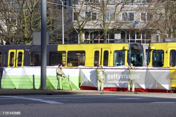 Security measurements are taken at the area after three people were killed when a gunman opened fire on tram passengers in Utrecht, Netherlands on...