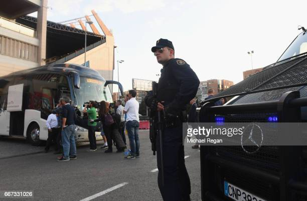Security measures are seen alongside the Leicester City team coach during a Leicester City training session and press conference on the eve of their...