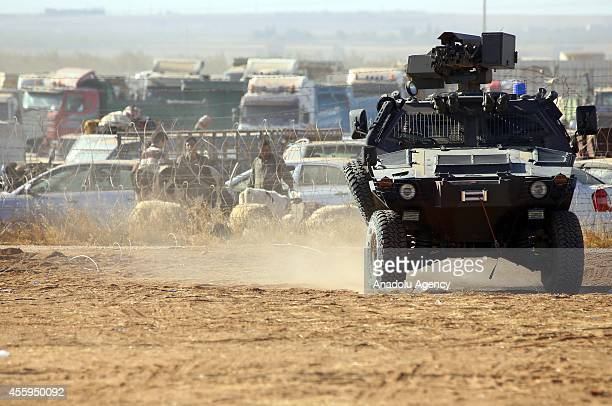 Security measures are taken as Syrians fleeing from clashes between ISIL militants and Democratic Union Party forces in the Tal Abyad district of...