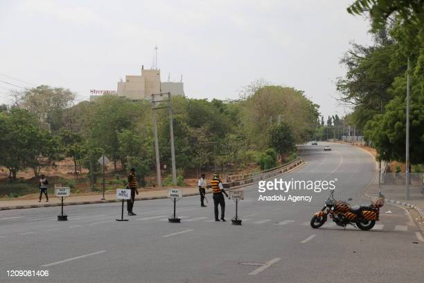 Security measures are taken as the curfew continues as part of coronavirus precautions in Abuja Nigeria on April 3 2020