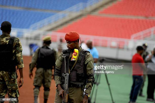 Security measures are taken during Equatorial Guinea's players training ahead of the 2015 Africa Cup of Nations soccer match between Equatorial...