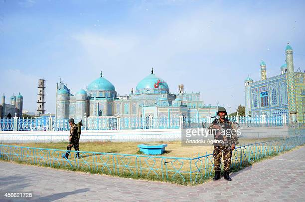 Security measures are taken outside the Blue Mosque when Muslims perform El alAdha prayer in MazariSharif Afghanistan on October 4 2014
