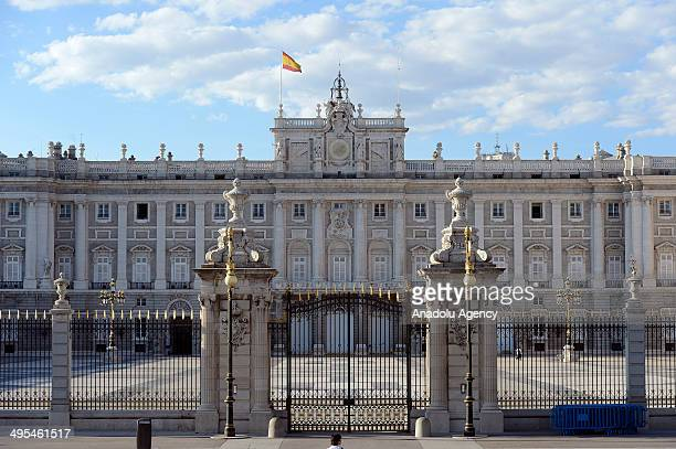 Security measures are tightened outside the royal palace in Madrid as thousands of Spaniards take to the streets on Tuesday calling for a referendum...