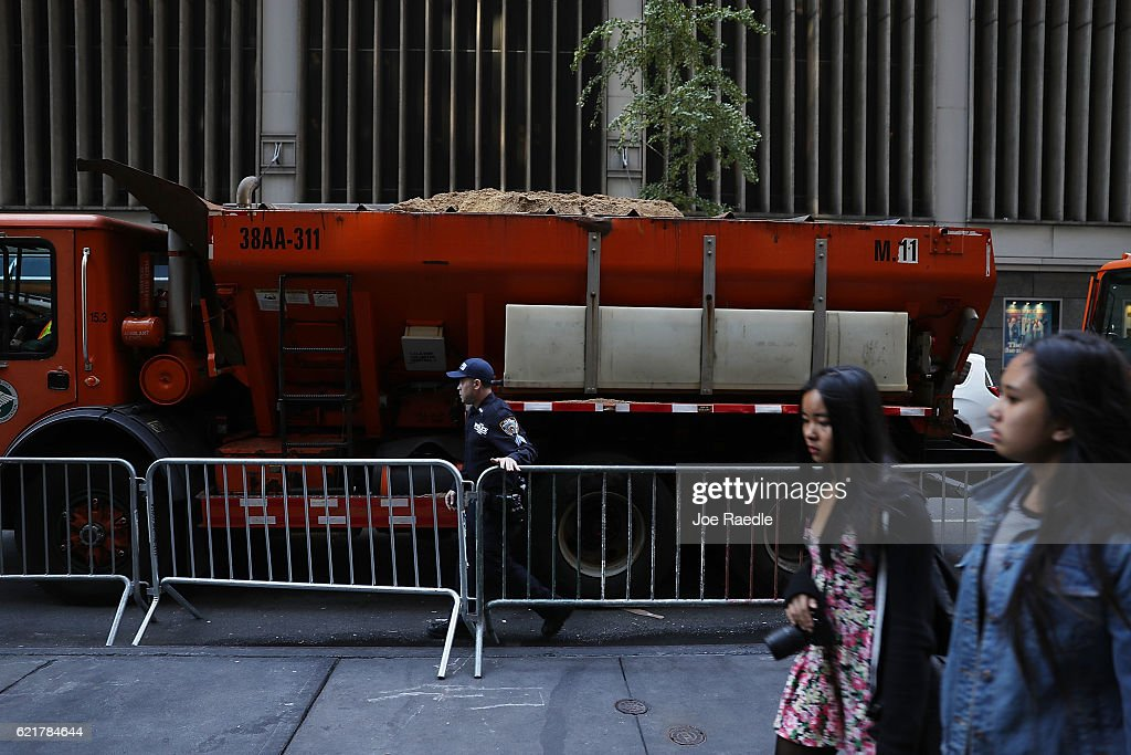 Security measures including barricades and a truck filled with sand are put in place outside the New York Hilton Midtown where Republican Presidential candidate Donald Trump will hold his election night party on November 8, 2016 in New York City. Voters head to the polls to decide the next President of the United States.