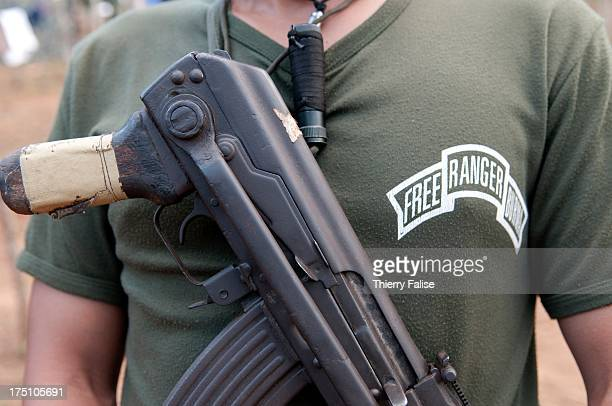 A security member of the relief group Free Burma Rangers with his gun