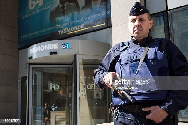 A security member stands guard at the gate of building of TV5Monde after the cyber attack in Paris France on April 09 2015 Frances government...