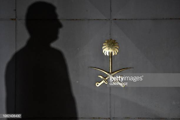 TOPSHOT Security members of the consulate wait in front of the gate door of the Saudi Arabian consulate on October 17 2018 in Istanbul Saudi Arabia's...