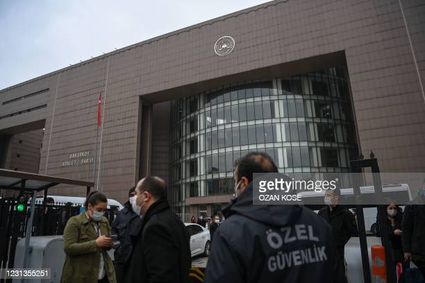Security members stand guard in front of the Bakirkoy courthouse in Istanbul, on February 24 after a verdict trial against four pilots, two flight...