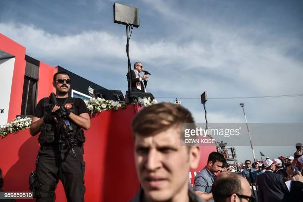 Security members stand in front of the stage as Turkish President Recep Tayyip Erdogan speaks during a protest rally in Istanbul on May 18 against...