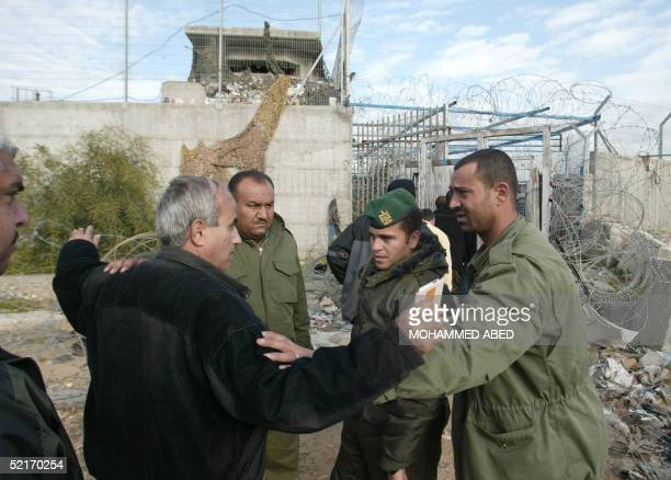 Security men checks a Palestinian worker at the entrance of Erez industrial zone in the northern Gaza Strip 10 February 2005 Palestinian construction...