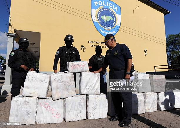 Security Minister Oscar Alvarez looks on October 7 2010 in Tegucigalpa at the 500kiloload of cocaine seized from traffickers during a joint operation...