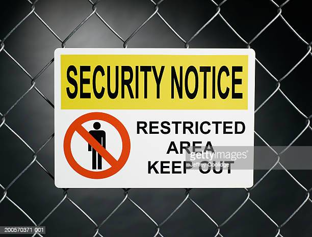 """""""Security notice, restricted area keep out"""" sign on fence"""