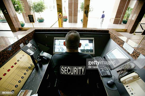 security officer at monitoring station - 警護する ストックフォトと画像