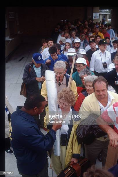 A security officer checks a woman's ID to verify that she is a resident of the Isle of Palms September 27 1989 in South Carolina Hugo is ranked as...