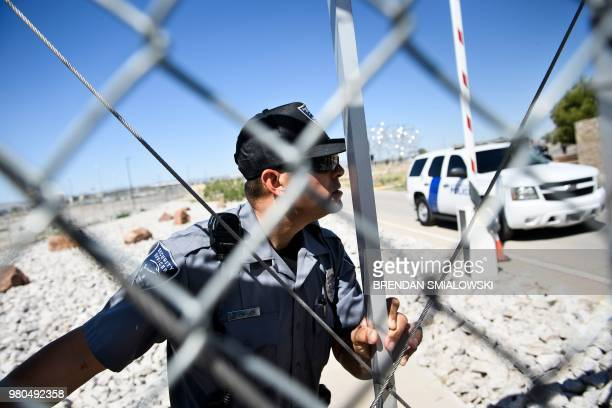 Security officer closes a gate to the Tornillo Port of Entry as mayors and others try and enter to visit with immigrant minors who are housed there...