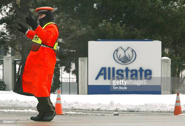 A security officer gestures with his hands as he directs traffic near Allstate's headquarters February 6 2004 in Northbrook Illinois Northbrook...