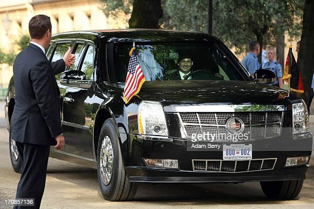 A security officer gives a thumbsup to the driver of 'The Beast' a modified Cadillac DTS that is the current US presidential limousine after US...