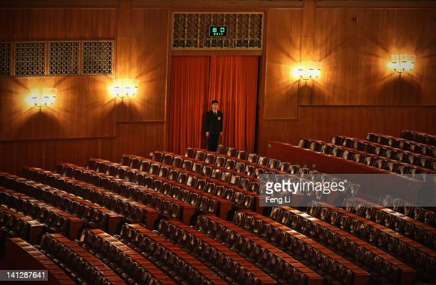 Security officer guards at the entrance of the meeting hall before the closing session of the National Peoples Congress at The Great Hall Of The...