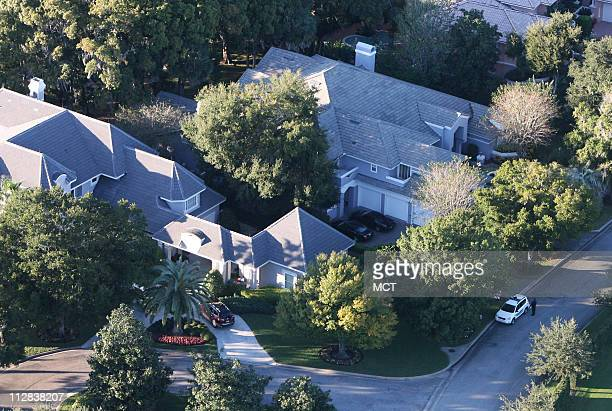 A security officer guards the area in front of Tiger Woods house in Windermere FL where he crashed into a fire hydrant and a neighbor's tree early in...