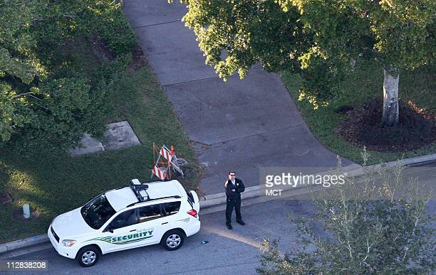 Security officer guards the area in front of Tiger Woods house in Windermere, FL where he crashed into a fire hydrant and a neighbor's tree early in...