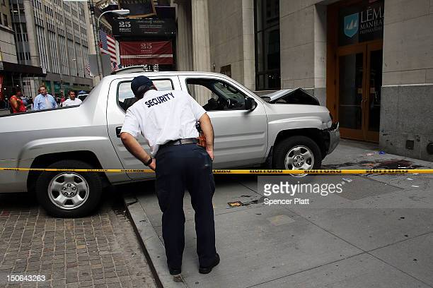 A security officer looks at the scene of a deadly truck crash in the financial district on August 23 2012 in New York United States The afternoon...