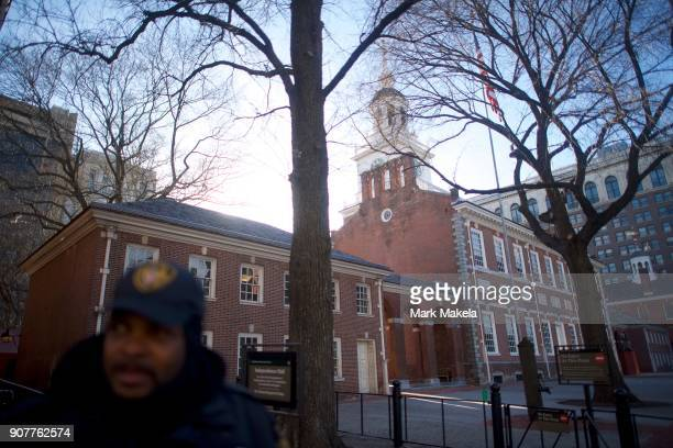 A security officer monitors activity in front of the shuttered Independence Hall after the government shutdown on January 20 2018 in Philadelphia...