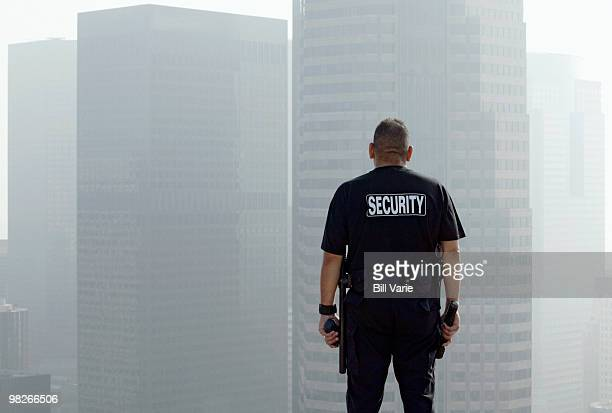 Security officer on roof of building