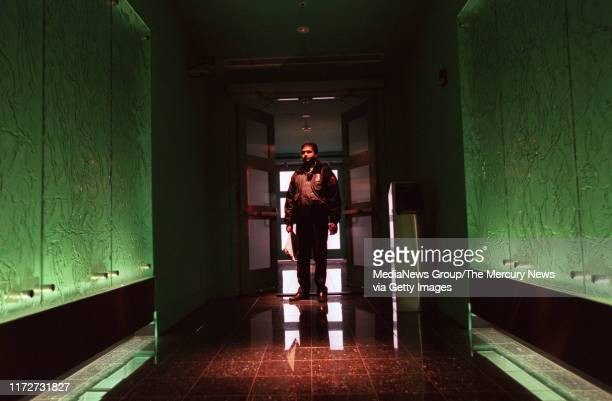 NEWS 3/5/01 Security Officer Ram Kamal walks through the entrance of a security mantrap before entering the main data storage facility at Equinix in...