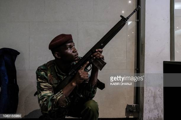 A security officer secures the building attached to the DusitD2 compound in Nairobi on January 15 after a blast followed by a gun battle rocked the...