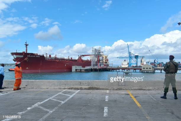 Security officer stand at the berth of an oil tanker carrying 200,000 barrels of crude oil worth Ksh 1.2 billion during the inaugural shipment of...