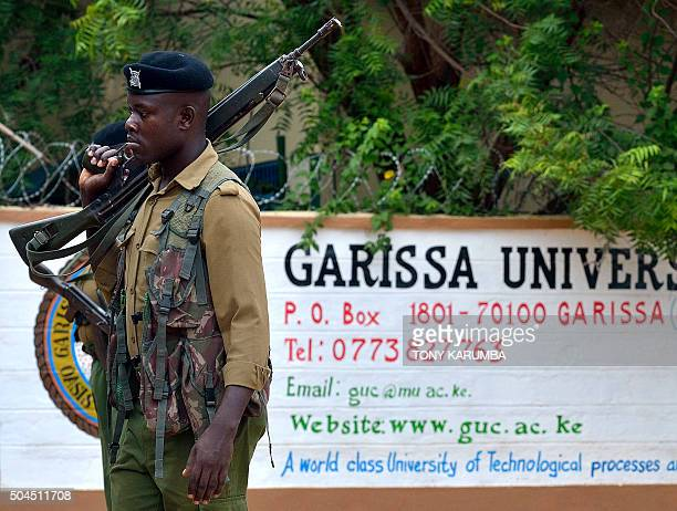 A security officer stands guard at the entrance of Garissa university college on January 11 2016 after it reopened following a deadly siege by four...