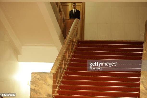 Security officer stands guard in the Great Hall of the People during the 19th National Congress of the Communist Party of China in Beijing, China, on...