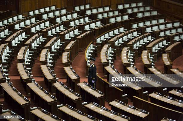 Security officer stands in the chamber ahead of a plenary session at the upper house of parliament in Tokyo, Japan, on Monday, Jan. 22, 2018. A plan...