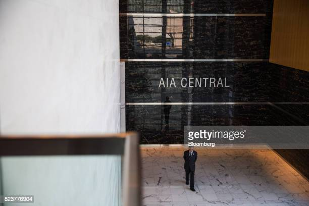 A security officer stands in the lobby of the AIA Central building which houses the headquarters of AIA Group Ltd in Hong Kong China on Friday July...