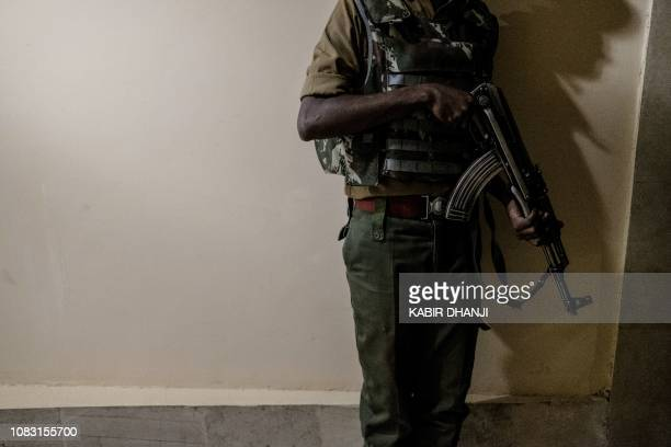 Security officer takes cover in the building attached to the DusitD2 hotel in Nairobi,on January 15 after a blast followed by a gun battle rocked the...
