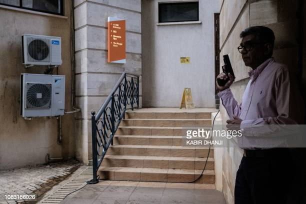 A security officer takes cover in the building attached to the DusitD2 compound in Nairobi on January 15 after a blast followed by a gun battle...