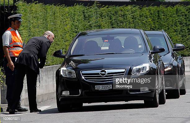 Security officers check cars arriving for the memorial service for Nicolas Hayek founder of Swatch Group AG at the Kursaal in Bern Switzerland on...