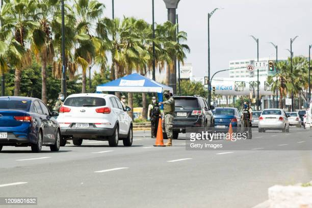 Security officers control vehicles at a checkpoint on April 13, 2020 in Guayaquil, Ecuador. Guayaquil is the epicenter of the COVID-19 pandemic in...