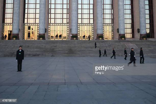 Security officers guard outside the Great Hall of the People before the opening session of the National People's Congress on March 5 2014 in Beijing...