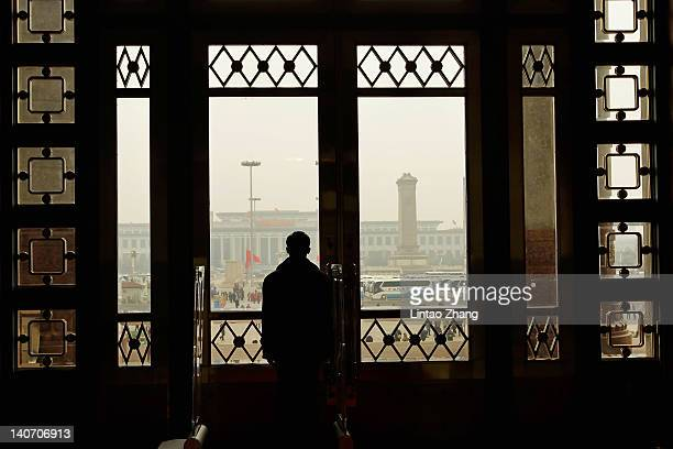 A security officers keep watch at the entrance of the Great Hall of the People during the opening ceremony of the National People's Congress at the...