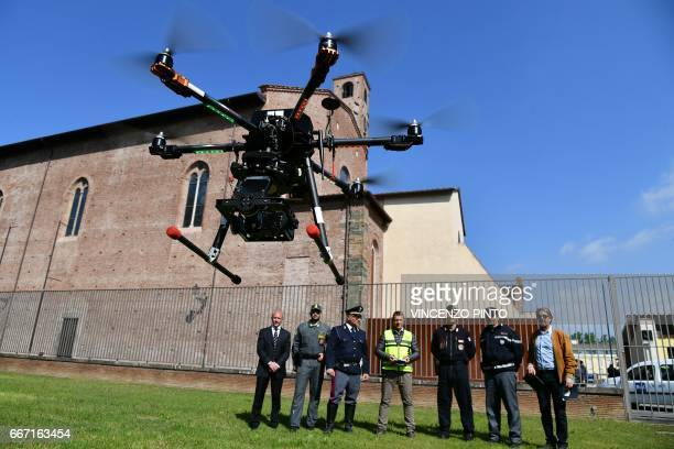 Security officers policemen and carabinieri look at a drone equipped with a thermal camera flying to securized the area during the meeting of Foreign...