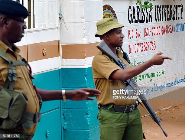 Security officers stand guard at the entrance of Garissa university college on January 11 2016 after it reopened following a deadly siege by four...