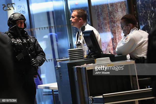 Security officers stand inside the entrance of Trump Tower on January 18 2017 in New York City Presidentelect Donald Trump is to be sworn in as the...